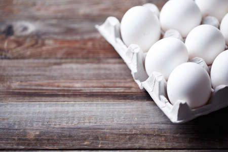 white eggs: White eggs on a rustic wooden table