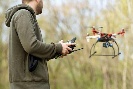 controling: Man controling a drone.