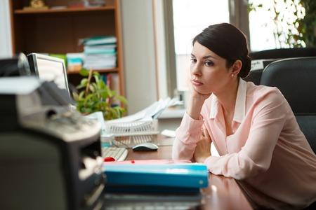 hot secretary: Tired businesswoman sleeping on the desk.