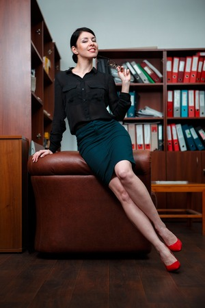 flirting: Woman with flirting pose in office.