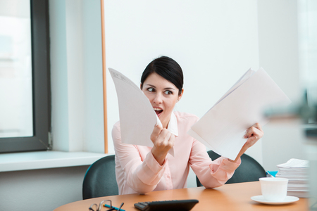 listless: Woman in office with crumpled paper. Office life concept. Stock Photo