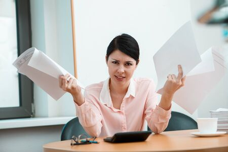 Woman in office with crumpled paper. Office life concept. Stock Photo