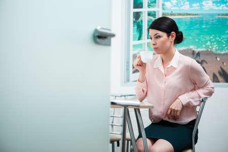 break in: Three businesswomen on the coffee break in the office