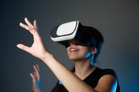 virtual reality simulator: Woman using the virtual reality headset. VR concept