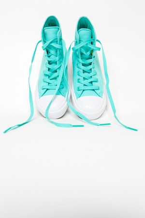 untied: Pair of shoes with long laces untied in white background