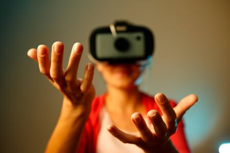 though: Woman looking though vr