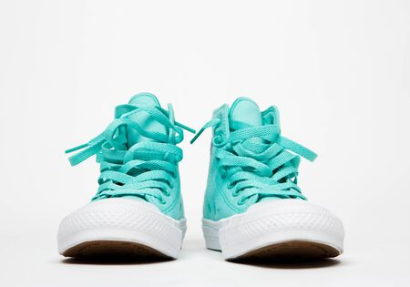 classic sneakers with laces on white rubber sole on white background Stock Photo