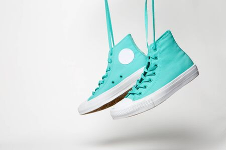 Pair of shoes with laces over white background