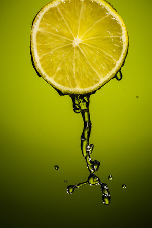 Water splash on lime. Background with vignette Stock Photo