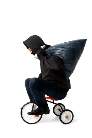 Theft goes on childrens bicycle with bag fill white background