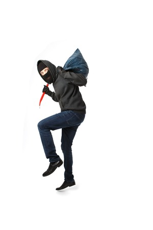 Prowling thief with passkey in his hand isolated on blank background