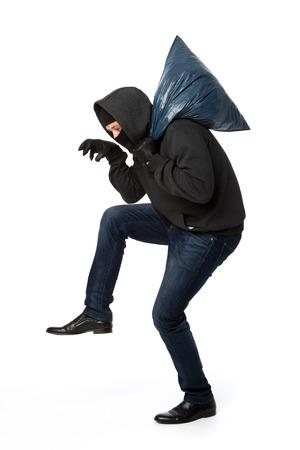 Burglar steals with blue bag on shoulder on pure white background