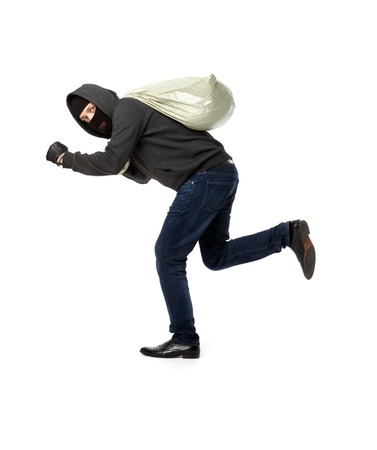 Thief run away with gray bag on pure white background Stock Photo
