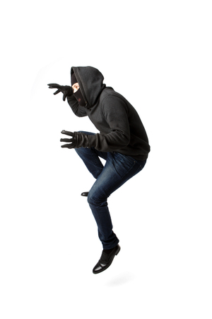 Prowling thief in black mask isolated on blank background