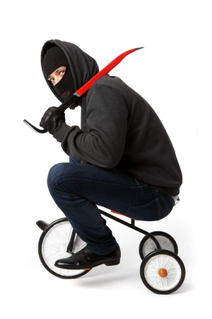 Robber going with passkey on little childrens bicycle on pure white background