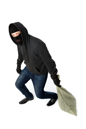 Thief in black gloves carries heavy bag on empty white background