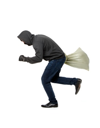Thief flees with gray sack on blank white background Stock Photo