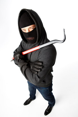 Attacker with master key on pure white background Stock Photo