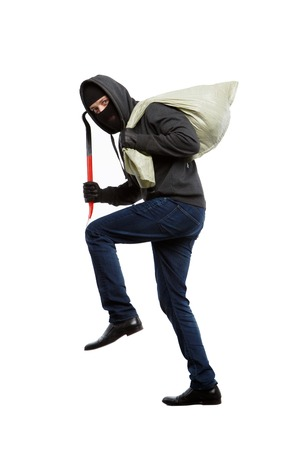 Thief in black mask with sack on blank white background