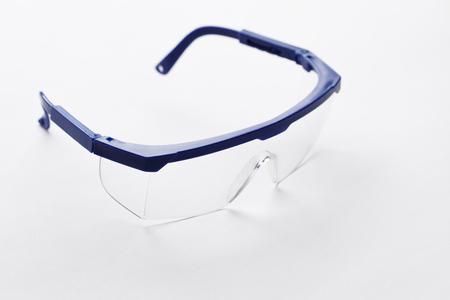 66036585 - Gafas protectoras con lentes transparentes sobre fondo blanco  puro 1f5a1bf0332f