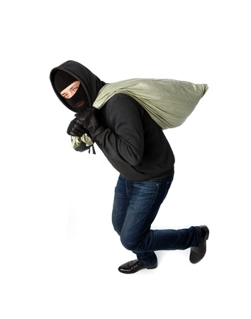 Thief running away with heavy black bag on shoulder on pure white background