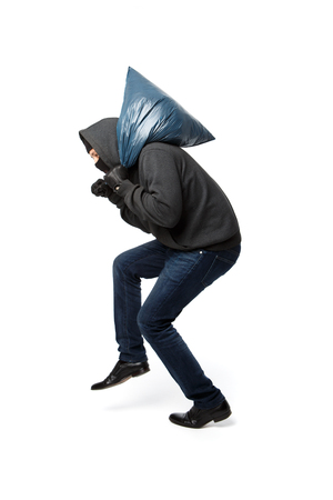 Robber slinking with large bag on pure white background