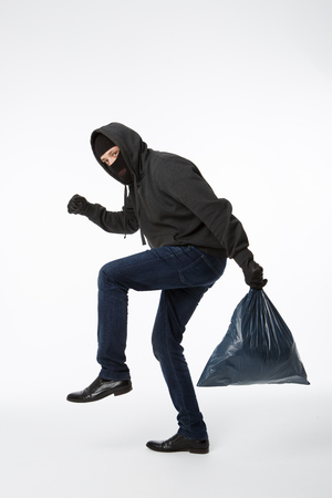 Thief slinking heavy blue bag on pure white background