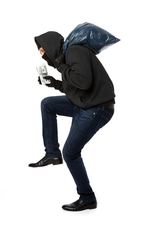 thief with bag on his shoulders on white background empty Stock Photo