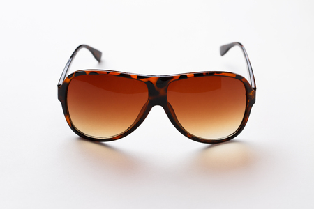 Leopard-rim sunglasses with brown lenses on pure white background
