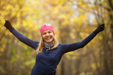 Sports girl doing exercises in forest in morning