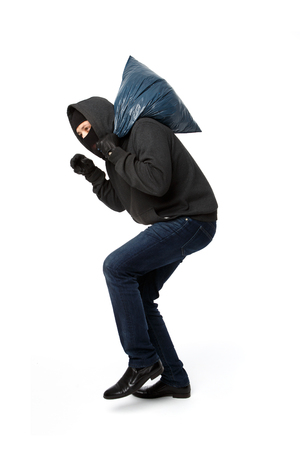 Burglar steals with large bag on pure white background