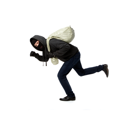 Thief escapes in black jacket with full bag on pure white background