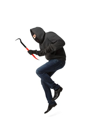 Thief jumps with master key in his hand isolated on blank background