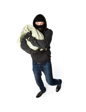 Robber hugging big sack of money on pure white background Stock Photo