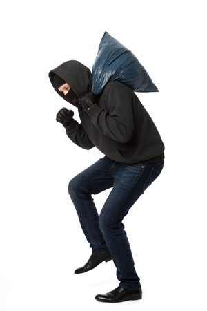 Robber steals with large bag on pure white background