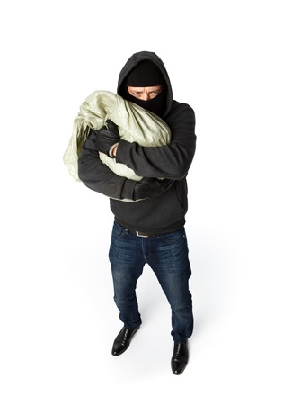 Terrible robber hugging big sack of money on pure white background Stock Photo