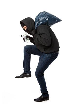 Theft slinks money and sack on blank white background Stock Photo