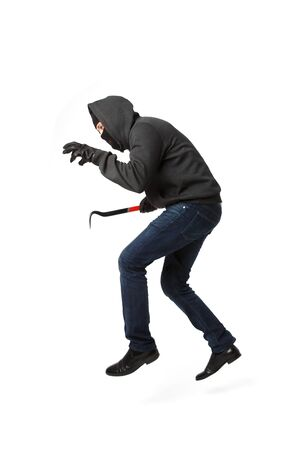 Jumping thief with master key in his hand isolated on blank background