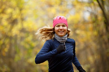 Happy girl with flowing hair runs in autumn park Stock Photo
