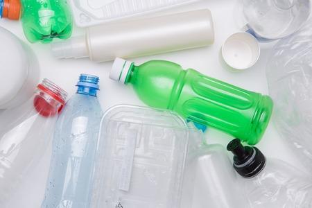 botellas pet: PET bottles for refining on empty white table Foto de archivo