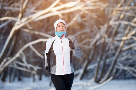 winter woman: Sport woman in winter forest Stock Photo