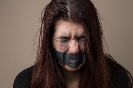 Woman hostage with gray tape