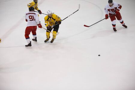 icehockey: Moscow, Russia - January, 07, 2017: Amateur hockey league LHL-77. Game between hockey team New Jersey 53 and hockey team Reds.