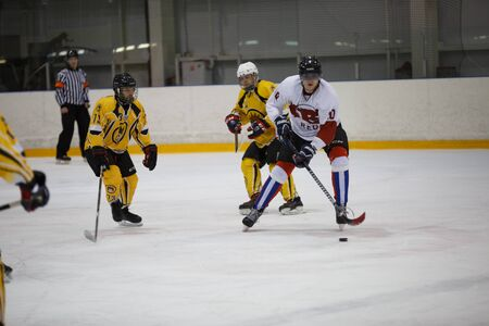 reds: Moscow, Russia - January, 07, 2017: Amateur hockey league LHL-77. Game between hockey team New Jersey 53 and hockey team Reds.