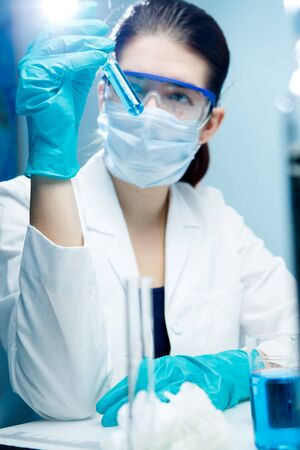 woman handle success: Photo of working laboratory assistant Stock Photo