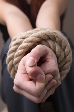 girl tied: Tied rope hands of girl