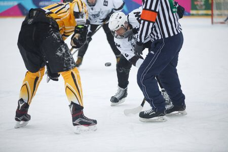 Moscow, Russia - January, 15, 2017: Amateur hockey league LHL-77. Game between hockey team New Jersey 53 and hockey team Black and white.