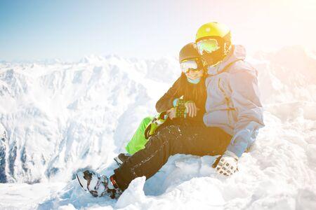 chearful: Couple hugging among winter mountain