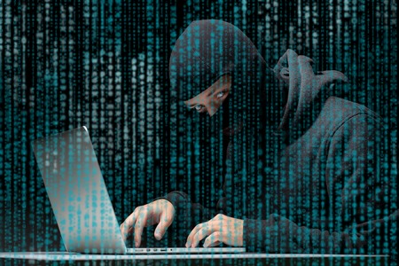Burglar picks password to laptop Stock Photo