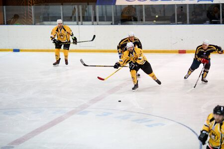 laying forward: Moscow, Russia - January, 22, 2017: Amateur hockey league LHL-77. Game between hockey team New Jersey 53 and hockey team Grizzly-2.